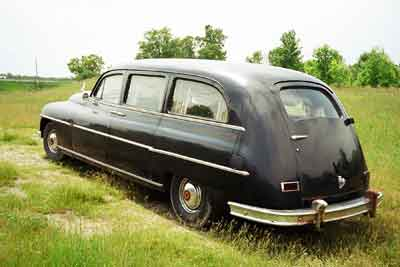 Image of 1949 Henney Packard Nu-3-Way hearse.